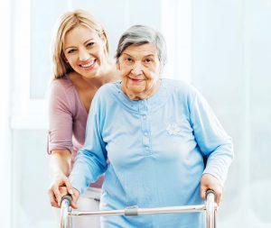 caregiver helping senior use assistive devices