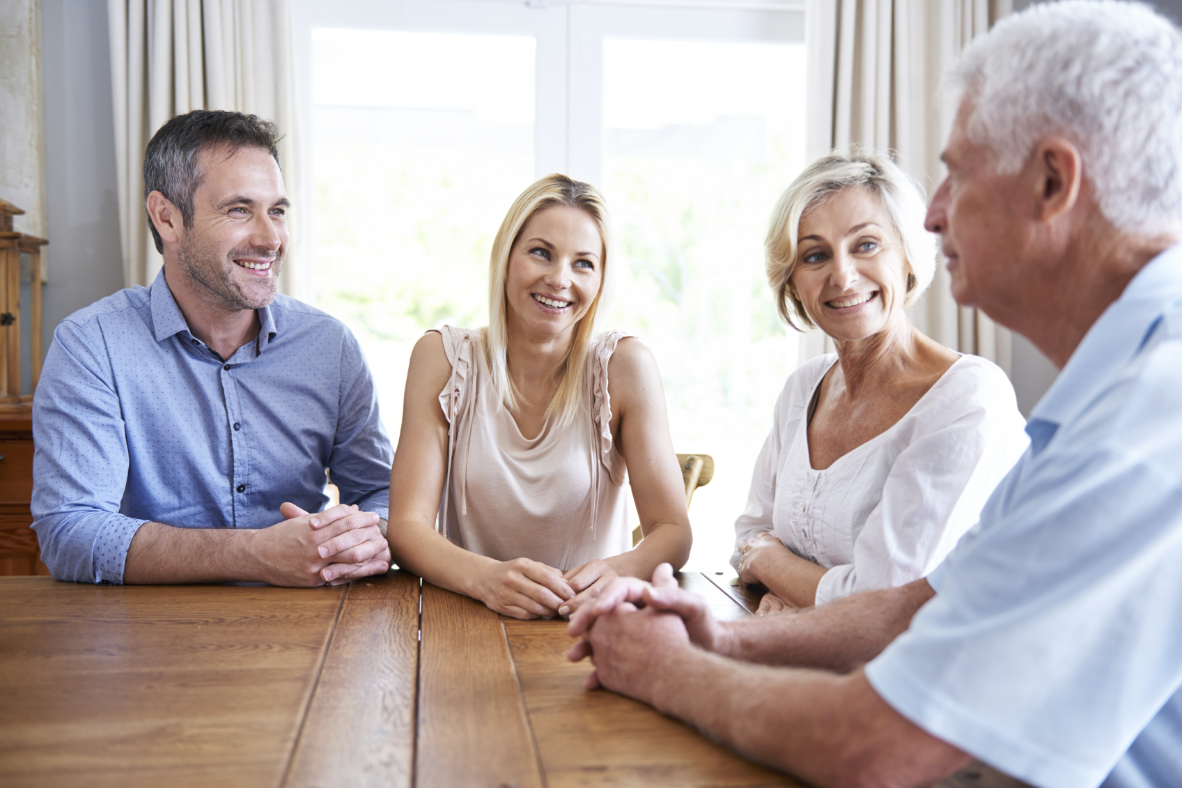 couple talking to senior parents about home care assistance costs
