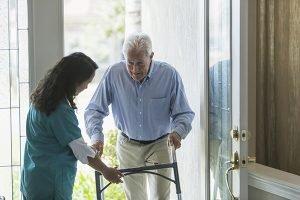 caregiver assisting senior man with dementia