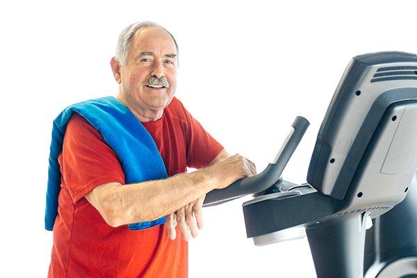 senior man with Parkinson's symptoms exercising