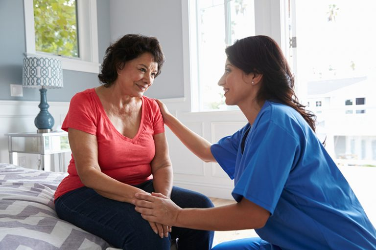 caregiver comforting senior with alzheimer's
